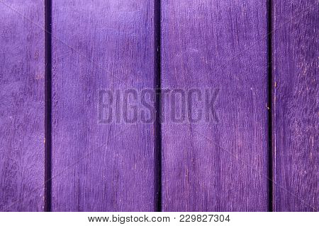 Purple Abstract Background Texture Of Wooden Decking With Parallel Planks With Gaps.