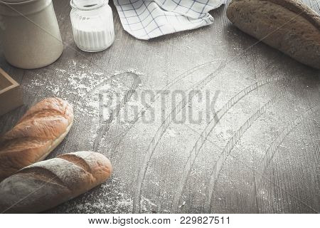 Bread And Bakery (food) Equipment (tools) On Wood Table Sprinkle With Flour.
