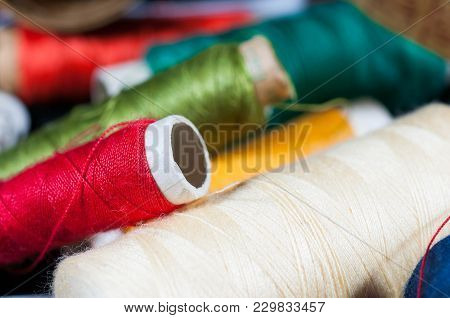 Colorful Threads Close Up Macro Shot, Focus On The Red Bobbin.
