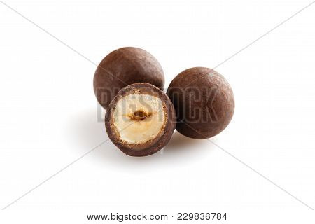 Heap Of Sugared Hazelnuts Dragees In Chocolate Isolated On White Background