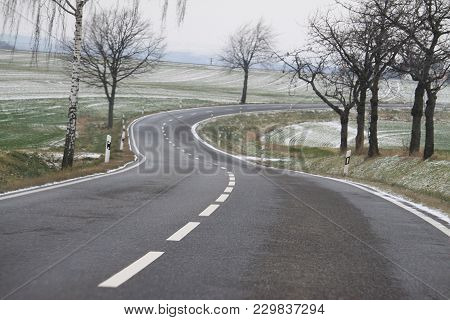 curvy lonely road on a foggy day poster