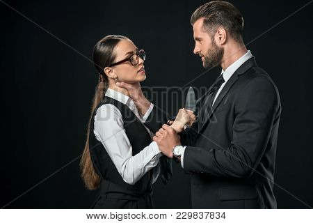 Business Partners Holding Knife And Quarreling Isolated On Black