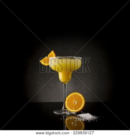 Orange Margarita Cocktail With Tequila, Triple Sec, Orange Juice, Crushed Ice And Some Salt On The R