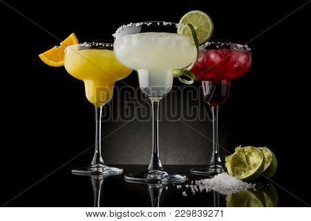Classic Lime Margarita, Orange Margarita And Cherry Margarita Cocktail Mix In Salt Rimmed Glasses Ga