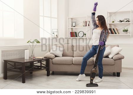 Happy Woman Cleaning Home, Dancing With Vacuum Cleaner And Having Fun, Copy Space. Housework, Chores