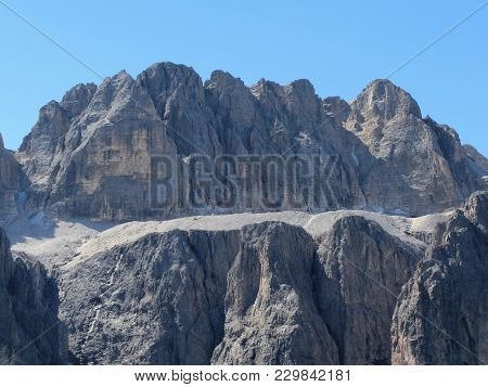 One Of The Mountain Peak Of The Italian Dolomites Against The Clear Blue Sky At Summer . Valgardena,