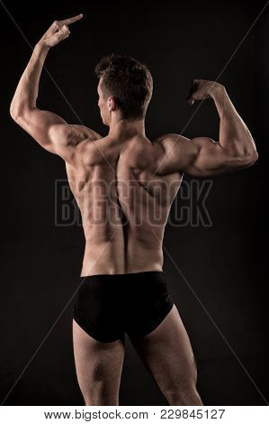 Sportsman With Strong Hands, Biceps, Triceps. Man Athlete With Muscular Body, Torso, Back View. Body