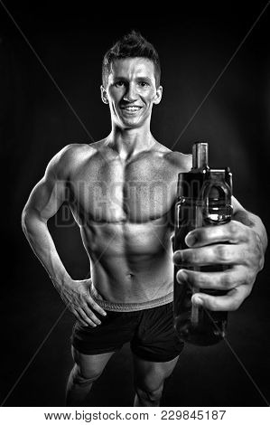 Man Athlete Smile With Fit Torso, Body. Sportsman With Sport Bottle On Dark Background. Thirst, Dehy