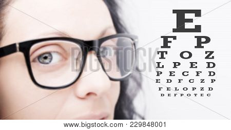 Beautiful Young Woman Wearing Glasses Close-up On White Background.