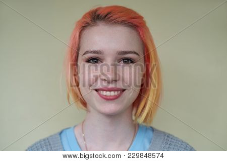 Close-up Portrait Of Young Blonde Short-haired Girl With The Wide Smile And Happy Face.