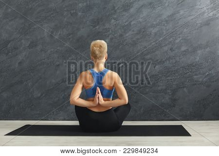 Young Woman In Yoga Class Making Asana Exercises. Girl Do Reverse Prayer Pose, Back And Shoulders St