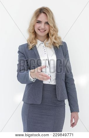 smiling business woman stretching hand for handshake.