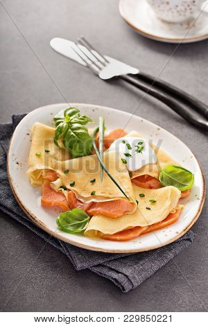 Savory Crepes With Salmon Filling And Sour Cream