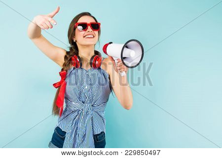 Brunette Cheerful Young Woman Dj With In Striped Shirt And Sunglasses On Blue Background With Copysp