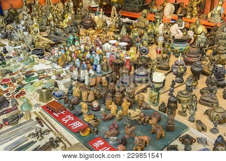 Chinese Bazaar With Miniature Ancient Figurines (feng Shui), Displayed For Sale At Tollwood Summer F