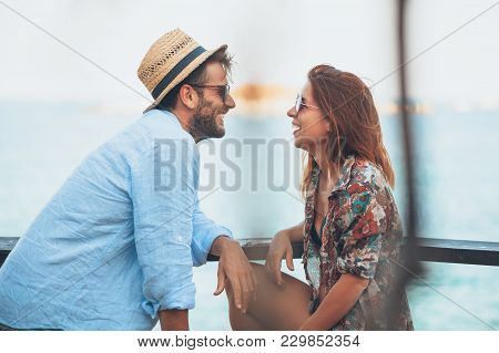 Young Couple Enjoying At The Beach Bar