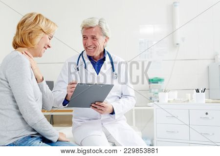 Happy woman visiting a doctor. She is getting a good analysis
