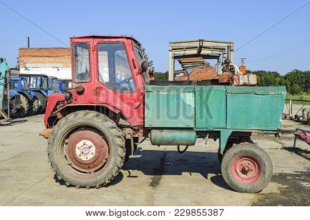 Russia, Temryuk - 15 July 2015: Agricultural Machinery Tractor. Tractor Beggar. Tractor With Front B