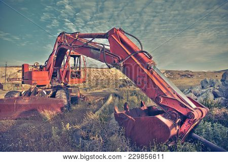 Track-type Loader Excavator Machine Doing Earth Moving Work At Green Field