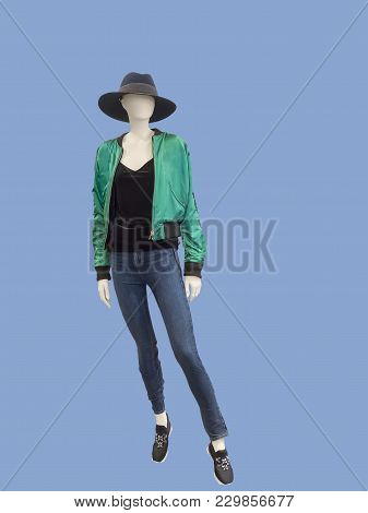 Full-length Female Mannequin Dressed In Jacket And Blue Jeans, Isolated. No Brand Names Or Copyright