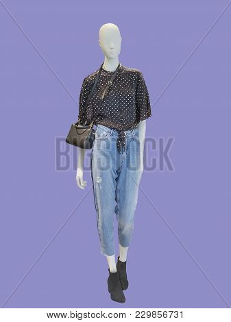 Full-length Female Mannequin Dressed In Blue Jeans And, Isolated. No Brand Names Or Copyright Object