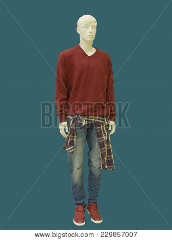 Full-length Male Mannequin Dressed In Sweater And Blue Jeans, Isolated. No Brand Names Or Copyright