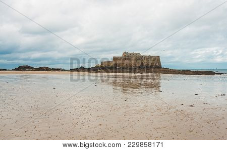 Low Angle Shot Of Fort National, 17-century Fortress On Island During Low Tide In Saint-malo, Britta