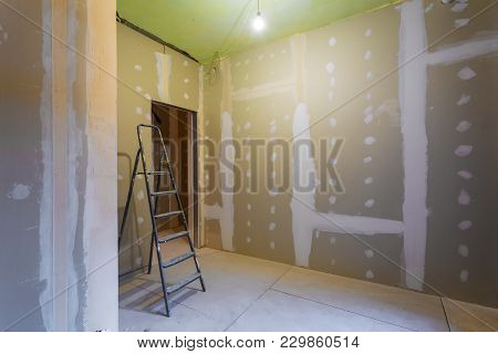Ladder And Room Interior With Plasterboard Drywall For Gypsum Walls Prepared To Painting In Apartmen