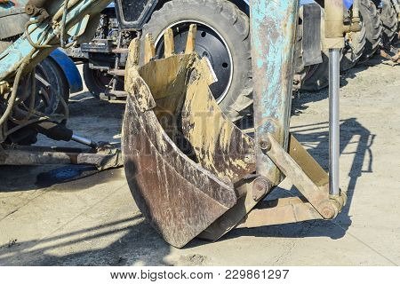 Tractor With A Bucket For Digging Soil.