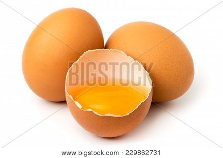 Chicken Eggs And Half With Yolk Isolated On A White Background.