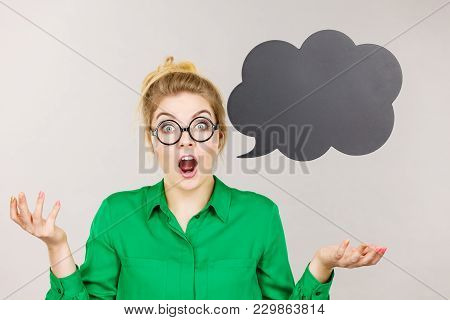 Shocked Astonished Business Woman Wearing Green Shirt With Black Thinking Or Speech Bubble.