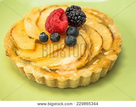 Apple Pie With A Clear Glaze And Berries