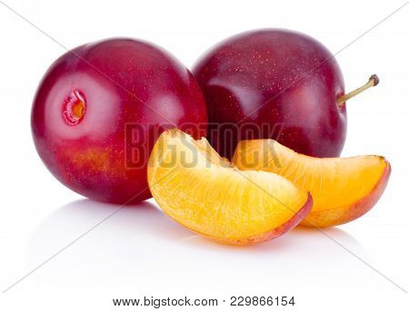 Fresh Plums And Slices Isolated On White Background