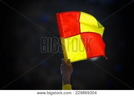 Linesman With Football Foul Flag On The Background Of The Stands