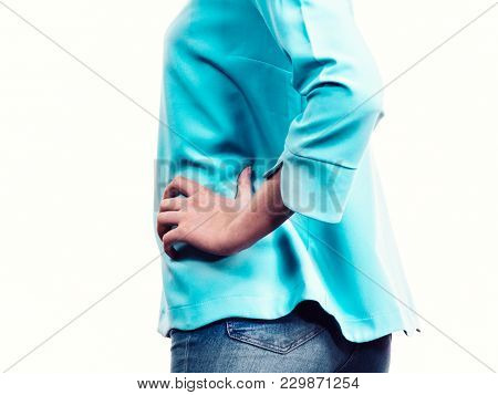 Unrecognizable Woman Presenting Her Casual Beautiful Outfit, Long Sleeved Blue Top And Jeans.