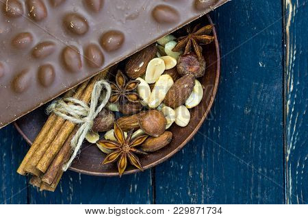 A Fragrant Coffee Composition. Coffee, Cinnamon And Nuts. Flat Lie. Low Key