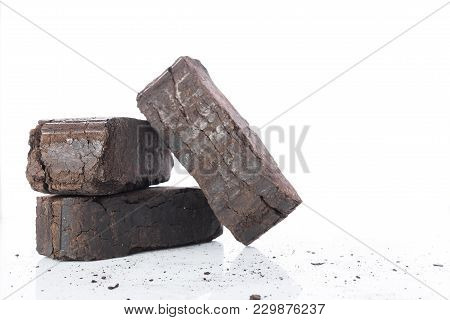 Peat Briquettes On White Background, Alternative Fuels, Raw Material, Place For Text