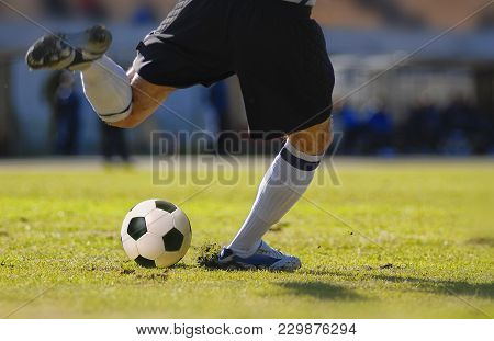 Soccer Player Kick The Ball During Football Match