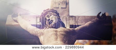 Suffering And Death Of Jesus Christ. View From The Bottom Of The Ancient Statue. (faith, Religion, R