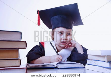 Child Girl Student Of Jurisprudence In A Judge Mantle Studying Laws. Humorous Photo.