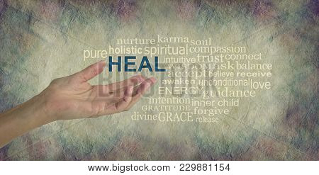 Humble Healing Words - Female Hand Gesturing Towards The Word Heal Surrounded By A Relevant Word Tag