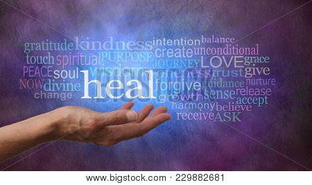 Heal Word Cloud - Female Hand Gesturing Towards The Word Heal Surrounded By A Relevant Word Tag Clou