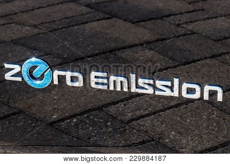 Indianapolis - Circa March 2018: Logo And Signage Of A Nissan Zero Emission Electric Vehicle (ev). N