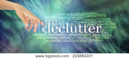 Consider Clutter Clearing Word Cloud - Female Hand With Index Finger Pointing Towards The Word Declu