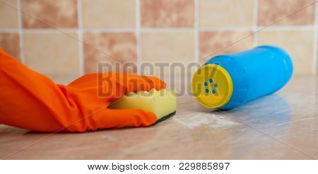 Hand In Orenge Rubber Gloves Wash The Surface Of The With A Soft Yellow Sponge Near The Scratched De