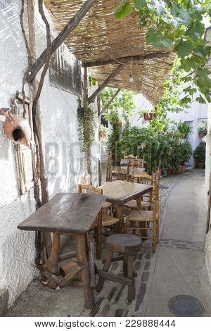 Quiet Narrow Lane With Restaurant Terrace At Capileira Town. Alpujarras, Granada, Spain
