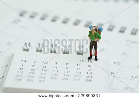 Travel Planning Or Vocation, Holiday Plan, Miniature People, Backpacker Man Figure Standing On White