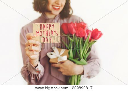 Happy Mother's Day Text On Greeting Card. Happy Woman Holding  Card And Pink Tulips And Gift Box, Sm