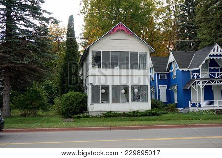 Bay View, Michigan / United States - October 16, 2017:  A Two Story White Victorian Cottage, With An