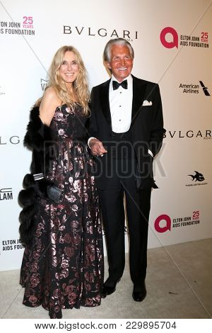LOS ANGELES - MAR 4:  Alana Stewart, George Hamilton at the 2018 Elton John AIDS Foundation Oscar Viewing Party at the West Hollywood Park on March 4, 2018 in West Hollywood, CA
